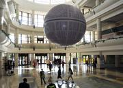 An inflatable Death Star hangs insideOrange County Convention Center during Star Wars Celebration 6.