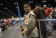 Isaac Castillo of Panama shows off his jedi costume in line at Orange County Convention Center before the start of Star Wars Celebration 6.
