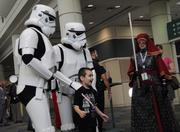 Members of the 501st Legion costume club pose with fans during Star Wars Celebration 6.
