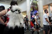 Genna Bigger of Tampa carries a Wampa backpack as she waits in line to enter Star Wars Celebration 6 at Orange County Convention Center.