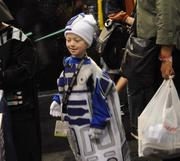 A young fan shows off a home made R2D2 costume at Star Wars Celebration 6.
