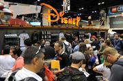 Disney even attracts crowds off property as fans gather to buy limited edition items at their vendor booth at Star Wars Celebration 6.