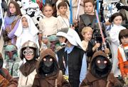 Members of the Galactic Academy, a younger version of the 501st Legion costume club, gather for a photo op.