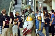 They didn't mess around with the security detail. A fan in a Boba Fett costume walks the halls during Star Wars Celebration 5.