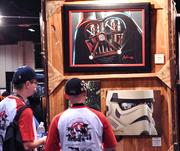 A display of Star Wars art by the Acme Archives collectible company drew lots of attention from fans on the exhibitor floor.