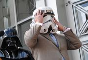 A clone at last. Mayor Dyer tries on his Stormtrooper helmet.
