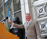 Mayor Dyer salutes the City Hall Plaza audience, Jedi style.