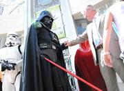Vader and Mayor Dyer shake hands on the steps of Orlando City Hall.