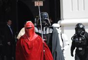 Members of the Makaze Squad, of the 501st Legion Florida Garrison, march to Orlando City Hall for Mayor Buddy Dyer's induction ceremony.
