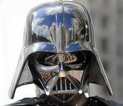 The Grand Bohemian Hotel and downtown Orlando reflected in Darth Vader's helmet as the induction ceremony ends.
