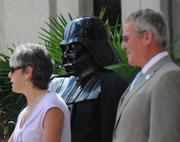 Darth Vader and Mayor Dyer look on as Orlando Science Center President and CEO JoAnn Newman addresses the crowd at City Hall Plaza.