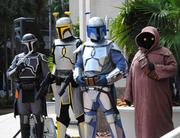 Members of the 501st Legion look on as Orlando Science Center President  and CEO JoAnn Newman addresses the crowd at City Hall Plaza.