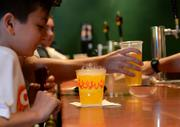 Max Couchman of London tries his first Flaming Moe. Lucky for the 11-year-old Max and his parents, it's non-alcoholic.