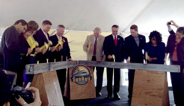 """SunRail held its official """"spike-hitting"""" — rather than groundbreaking — of its first phase in January 2012."""
