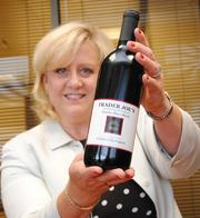 arrie Duvall Davis of BB&T holds a bottle of wine she bought at the newest Trader Joe's in Sarasota.