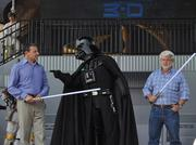 Bob Iger, Darth Vader and George Lucas at last year's grand opening of Star Tours 3D. The wheels may have been in motion, but we were too pumped to ride the ride to notice.
