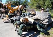Animal and dinosaur sculptures await salvage or repair at Florida Creative Industries.