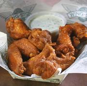 Richardson-based Wingstop is expanding domestically and overseas.