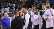 Team mates and coaches watch as New Your Knicks rookie star Jeremy Lin is interviewed before practice for the BBVA Rising Stars Challenge at Orange County Convention Center on Friday.