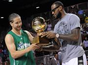 LeBron James presents Kenny Dobbs with the Sprite Slam Dunk Showdown Championship trophy.
