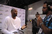 OBJ reporter Richard Bilbao interviews Kobe Bryant at Orange County Convention Center on Friday.
