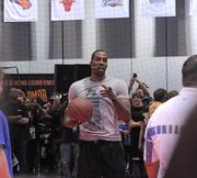 Dwight Howard gives pointers to some fans during a basketball clinic at Orange County Convention Center on Friday.