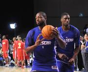 From left: Dwyane Wade of the Miami Heat and Roy Hibbert of the Indiana Pacers during an NBA All Star team practice at Orange County Convention Center on Saturday.
