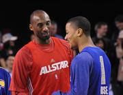 Kobe Bryant of the Los Angeles Lakers and Derrick Rose of the Chicago Bulls talk before an NBA All Star team practice at Orange County Convention Center on Saturday.