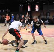Basketball fans test their skills against each other in three-on-three maches at the NBA All Star Jam Session.