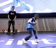 Brandon Macian of Mexico watches as 8-year-old Eric Parnell of Melbourne, Florida shows off his moves during a dance competition at the NBA All Star Jam Session.