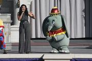 Sparks sang a medley of Disney songs in the company of characters.