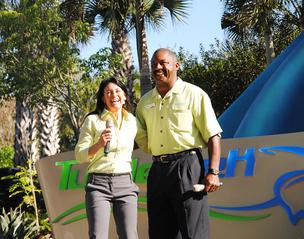 from left: Sea World Orlando Animal Ambassador Julie Scardina and Sea World Orlando President Terry Prather welcome guests to the opening of Turtle Trek.