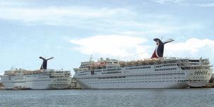 Carnival cruise ships are docked at a port in south Florida. Information about the Carnival Triumph, stranded in the Gulf of Mexico since an engine fire Sunday, has been flowing sporadically to WBJ Editor Bill Roy from his wife, who's stuck on board.