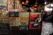 License plates, photos, and graffiti from generations of visitors decorate the walls at Boot Hill Saloon.