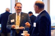 Bob Garrison, of Centennial Bank, talks with guests at OBJ's Modeling and Simulation Power Breakfast.