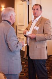 Scott Kidd, of AGNI Corp., attends the power breakfast on the modeling and simulation industry June 22 at the Citrus Club in downtown Orlando.