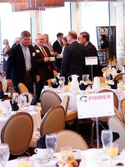 Guests begin to fill the room at the Citrus Club in downtown Orlando for OBJ's Power Breakfast on the modeling and simulation industry.