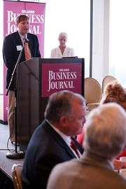 Brian Clark of C&S Companies speaks at the power breakfast on June 22.