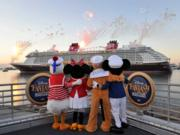 Donald Duck, Minnie Mouse, Pluto and Mickey Mouse welcome the Disney Fantasy cruise ship as it arrives at Port Canaveral on Tuesday, March 6.