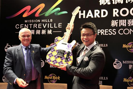 Hamish Dodds, president and CEO of Hard Rock International, and Dr. Ken  Chu, chairman of Mission Hills Group, celebrate the announcement of Hard  Rock Hotels Shenzhen and Haikou  in Shenzhen, China.