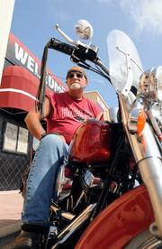 """Chuck Kushlan of Ohio has attended Daytona Beach Bike Week for the past 20 years. This year he's decided to stay in Daytona. """"I've had enough of winter,"""" he said."""