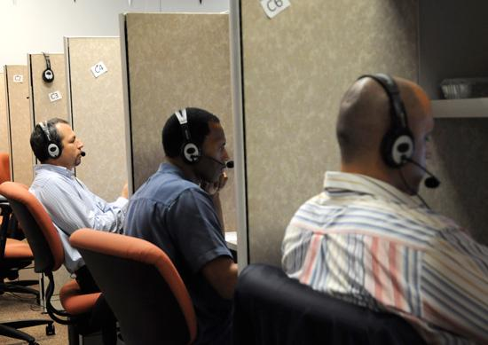 Softrock employees man the phone banks at the company offices in MetroWest. More hiring is in the works.