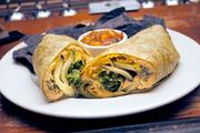 """Ethos Vegan Kitchen's """"The Hippie Wrap"""" — made with homemade hummus, sprouts, cucumbers, banana peppers, tomato and lettuce"""