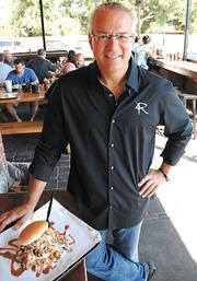 Best barbecue in Central Florida: 4 Rivers Smokehouse. Shown: Owner and pit master John Rivers