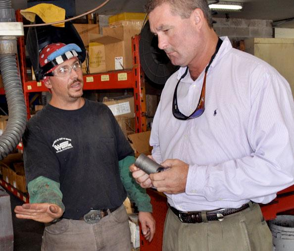 Wayne Automatic Fire Sprinklers Inc's Mike Chicarelli and Clark Gey at the company's Ocoee headquarters