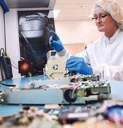 L-3's Jennifer Penrose assembles laser systems.