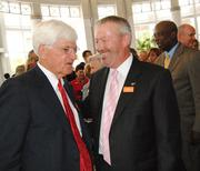 Arts center chairman Jim Pugh and Orlando Mayor Buddy Dyer after the May 23 vote.