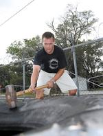 <strong>Schulke</strong> works off steam with sledgehammers, tractor tires