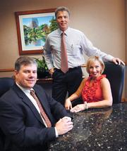 from left: Rich Davis, David Calcanis and Nicole Barry, formerly of Grubb & Ellis, are now at Cushman Wakefield.