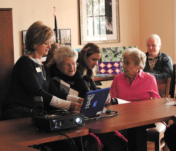 Michelle Shattock (center) of Sonata Health Care assists residents with an educational program taught by Leigh Elliott (left) of Team Elliott Education.